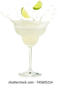 lime slice falling into daiquiri cocktail isolated on white