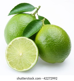 Lime with lime slice isolated on a white background.