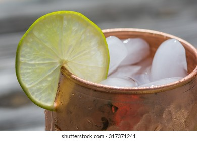 Lime slice on copper cup