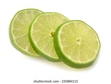 lime sliced and stacked on white