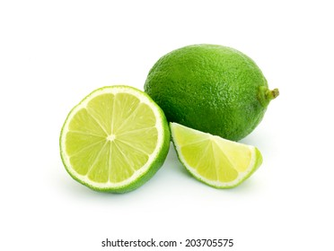 Lime with slices isolated on white background