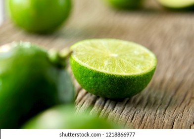 lime slices on wooden table. Detox diet, limes Backgrounds, Close up shot, fruit macro photography