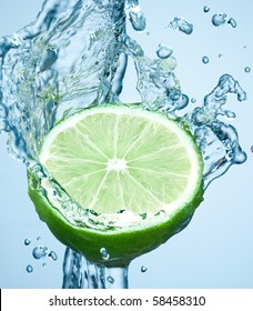 lime in spray of water. lime cucumber with splash on background