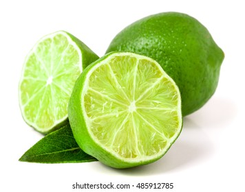 lime with two halves and leaf isolated on white background