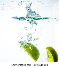 Lime in water with fresh bright green splash
