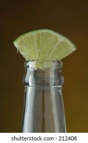 Lime wedge in beer bottle