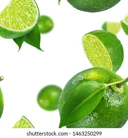 Lime whole and halved on white background. Seamless texture or pattern