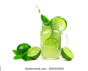 Limeade in a mason jar glass with fruit, mint and straw isolated on a white background