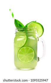 Limeade and mint in a mason jar glass with straw isolated on a white background
