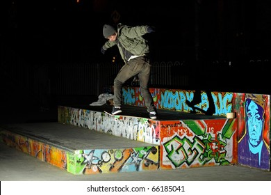 LIMERICK CITY, IRELAND - 28 NOV: Amateur skate boarder Cian Eades, filming skateboard footage for JART skateboards on 28th NOV, 2010 at Limerick City Skate Park, Ireland.
