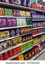 Limerick, Ireland - Feb 12th, 2017: Famous Easter tradition in Ireland and Europe , giving chocolate Easter eggs as a gift. Selection of chocolate candy sweet easter eggs on shelves in a shop store.