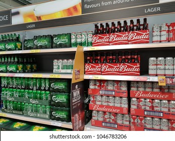 Limerick, Ireland - Mar 15th, 2018:Selection of larger beers carlsberg budweiser on shopping shelves in a supermarket.