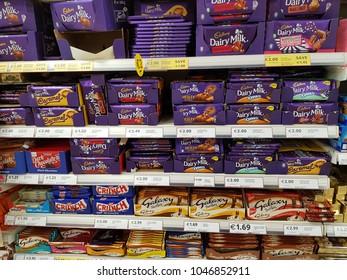 Limerick, Ireland - Mar 15th, 2018:Selection of Cadbury diary milk chocolate on shopping shelves in a supermarket.