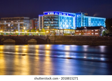 Limerick, Ireland - November 21, 2010: Modern architecture of the Strand Hotel reflected in Shannon River at night, Limerick.