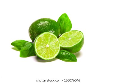 Limes composition One whole lime, two half limes, with leaves, isolated on white
