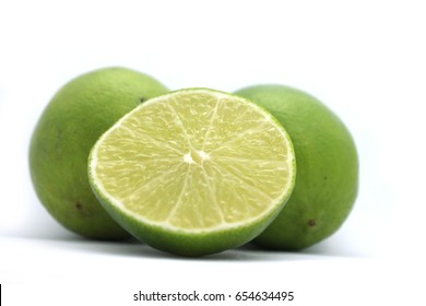 Limes cut half,white background
