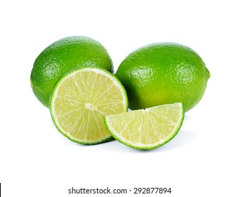 Limes with half isolated on white background