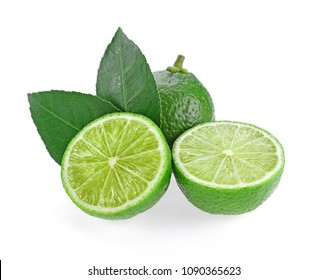 limes with leaf on white background