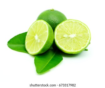 limes and lime slice on white background.