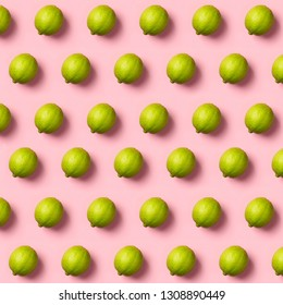 Limes pattern on pink background. Creative food concept. Flat la