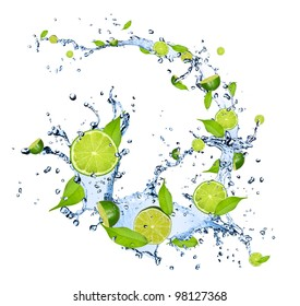 Limes pieces falling in water splash, isolated on white background
