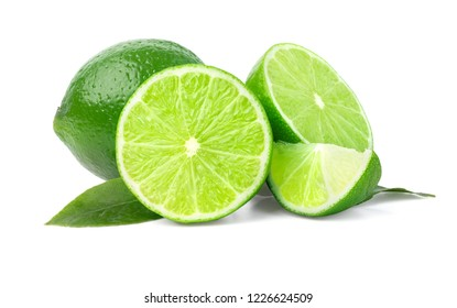 Limes with slices and leaves isolated on white background, with clipping path