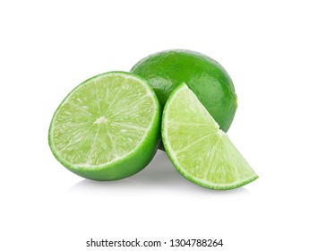 Limes with slices and leaves isolated on white background.