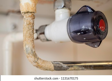 Limescale. Hard water plumbing damage on a boiler pipe. Calcium carbonate build up on a badly maintained hot water system.