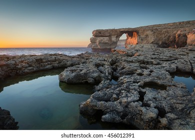 Limestone arch, at sunset know as the Azure Window, in Dwerja, Gozo, Malta. This location was used as a wedding scene in Game of Thrones, as Daenerys Targaryen marries the Dothraki warlord Khal Drogo.
