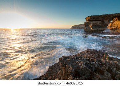 Limestone arch, at sunset know as the Azure Window, in Dwerja, Gozo, Malta.This location was used as a wedding scene in Game of Thrones, as Daenerys Targaryen marries the Dothraki warlord Khal Drogo.