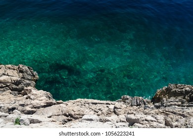 Limestone cliff and clear blue-green sea at the coast of Istria peninsula, Croatia