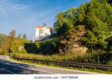 "Limestone cliff Pieskowa Skala near Krakow, Poland, with isolated rock ""Maczuga Herkuklesa"" Hercules's mace (Hercules cudgel or bludgeon) and historic Renaissance castle - Shutterstock ID 1947788344"