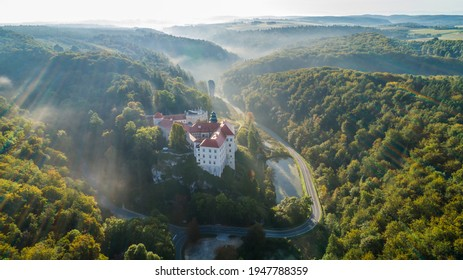 "Limestone cliff Pieskowa Skala near Krakow, Poland, with isolated rock ""Maczuga Herkuklesa"" Hercules's mace (Hercules cudgel or bludgeon) and historic Renaissance castle - Shutterstock ID 1947788359"