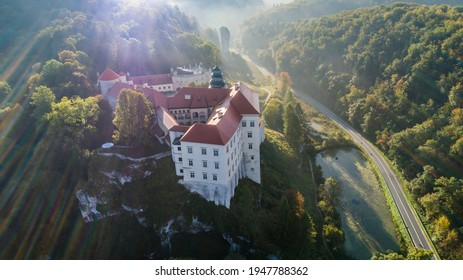 "Limestone cliff Pieskowa Skala near Krakow, Poland, with isolated rock ""Maczuga Herkuklesa"" Hercules's mace (Hercules cudgel or bludgeon) and historic Renaissance castle - Shutterstock ID 1947788362"
