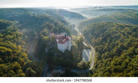 "Limestone cliff Pieskowa Skala near Krakow, Poland, with isolated rock ""Maczuga Herkuklesa"" Hercules's mace (Hercules cudgel or bludgeon) and historic Renaissance castle - Shutterstock ID 1947788368"