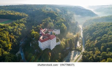 "Limestone cliff Pieskowa Skala near Krakow, Poland, with isolated rock ""Maczuga Herkuklesa"" Hercules's mace (Hercules cudgel or bludgeon) and historic Renaissance castle - Shutterstock ID 1947788371"