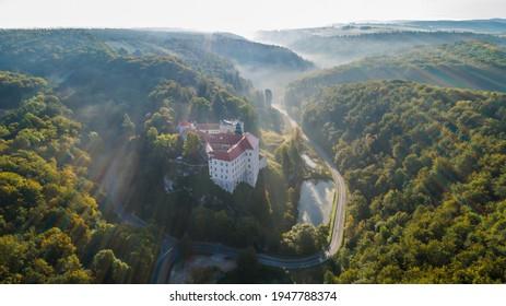 "Limestone cliff Pieskowa Skala near Krakow, Poland, with isolated rock ""Maczuga Herkuklesa"" Hercules's mace (Hercules cudgel or bludgeon) and historic Renaissance castle - Shutterstock ID 1947788374"