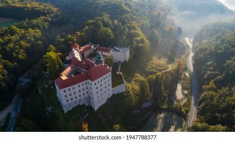 "Limestone cliff Pieskowa Skala near Krakow, Poland, with isolated rock ""Maczuga Herkuklesa"" Hercules's mace (Hercules cudgel or bludgeon) and historic Renaissance castle - Shutterstock ID 1947788377"