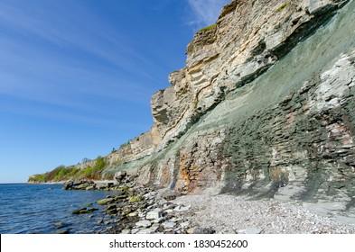 Limestone cliffs in Paldiski on the shores of the Baltic Sea. clear sunshine and blue sky. Paldiski, Estonia