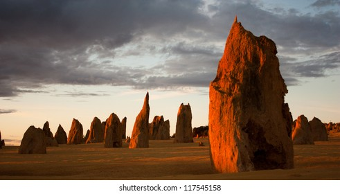 Limestone formations glowing red at last light in the Pinnacles desert in Nambung National Park, Western Australia