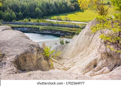 Limestone formations surrounding abandoned Rummu quarry in Estonia