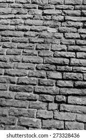 Limestone fortress wall in Tallinn, Estonia. Black and white.