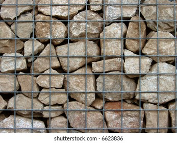 Limestone gabian wall, showing steel mesh grid