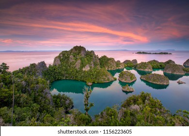 Limestone islands form a remote lagoon in Pianemo Island View Point, Blue Lagoon, Raja Ampat, West Papua, Indonesia