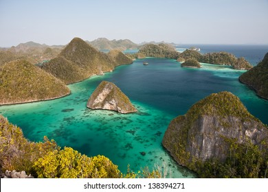 Limestone islands form a remote lagoon in northern Raja Ampat, Indonesia.  This aesthetic area is known as Wayag.