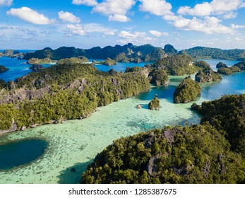 Limestone islands in Raja Ampat, Misool,Indonesia, are surrounded by clear blue waters.