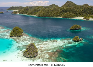 Limestone islands rise from a gorgeous lagoon in Wayag, Raja Ampat, Indonesia. This remote, tropical region is known as the heart of the Coral Triangle due to its incredible marine biodiversity.