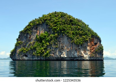 Limestone islet of the Hong islands archipelago in the Phang Nga Bay