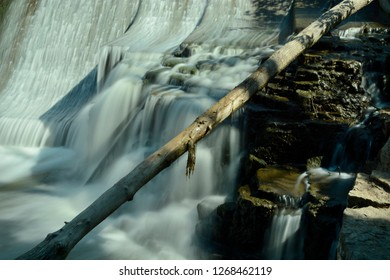 A limestone outcropping along the side of the Horlick dam in Racine.  The time exposure calms the water while a long tree limb gives depth to the image in this special effect photograph.
