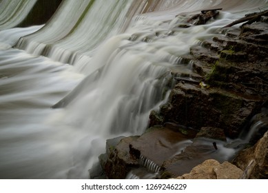 The limestone outcropping on the east side of the Horlick Dam in Racine Wisconsin on a summer day with a time exposure enhancing the movement of the water.